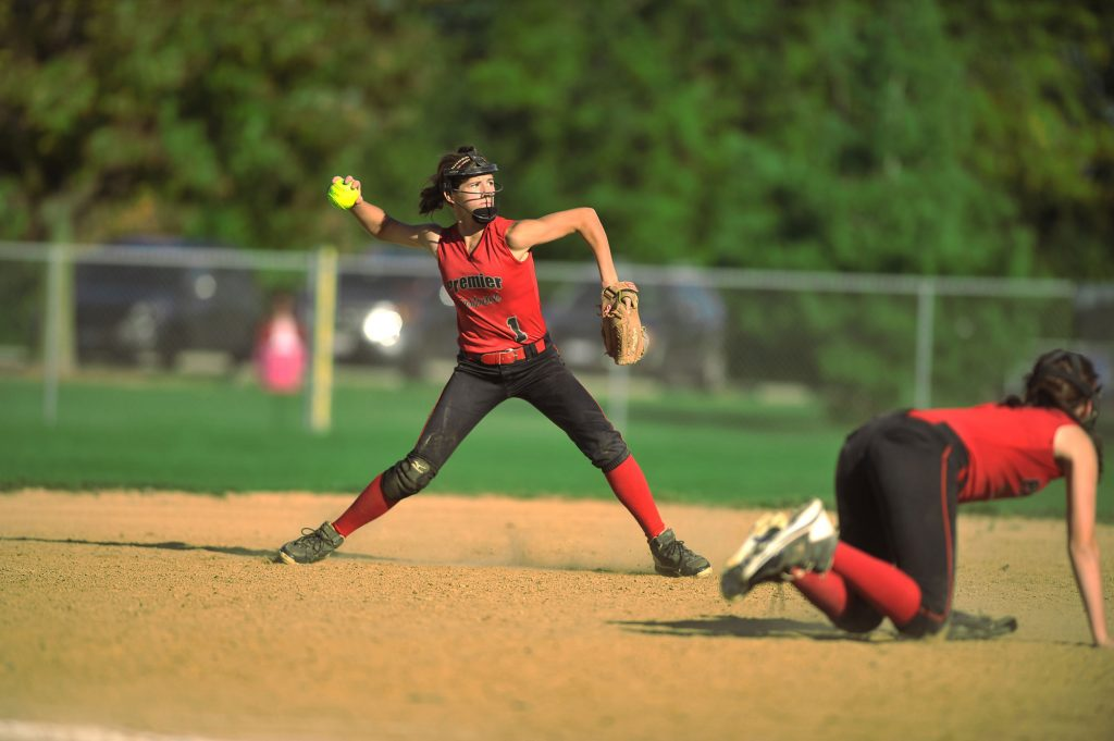 Infield softball player throwing the ball